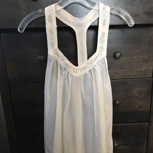 White flowy dress with intricate design